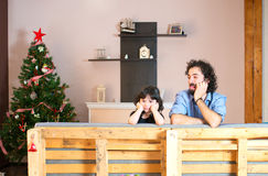 Girl upset because of not receiving Christmas gifts Stock Photography