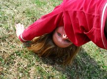 Girl upside down Royalty Free Stock Images