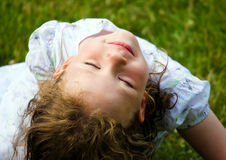 Girl upside-down - eyes closed Royalty Free Stock Images