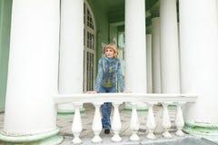 Girl in an urban denim near white balustrade Royalty Free Stock Photos