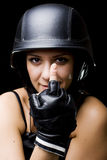 Girl with US Army-style helm showing middle finger Royalty Free Stock Photos