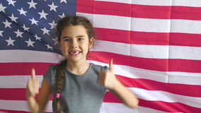 Girl and USA American Flag. Boy teen shows gesture yes Independence Day American usa flag Fourth of July stock video