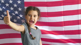 Girl and USA American Flag. Boy teen shows gesture yes Independence Day American flag usa Fourth of July stock footage