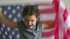 Girl and USA American Flag. Girl  shouting teen holding usa American flag Independence Day stock video footage