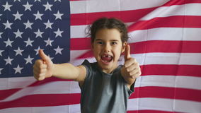 Girl and USA American Flag. Teen boy shows gesture yes Independence Day American usa flag Fourth of July stock video footage