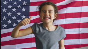 Girl and USA American Flag. Teen boy shows gesture yes  Independence usa Day American flag Fourth of July stock footage