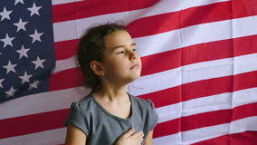 Girl and USA American Flag. Teen girl  holding hands on the heart usa  Independence Day American flag Fourth of July stock footage