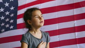Girl and USA American Flag. Teen  girl holding hands on the usa heart  Independence Day American flag Fourth of July stock video footage