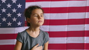 Girl and USA American Flag. Teen girl  holding hands on the heart  Independence usa Day American flag Fourth of July stock video