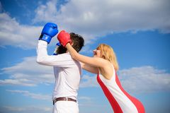 Girl use cunning trick in fight. Couple in love boxing gloves blue sky background. Girl close his eyes boxing gloves. Cunning strategy win. Savvy key to royalty free stock photography