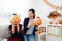 Girl use pumpkin lantern to cover her face Stock Photo