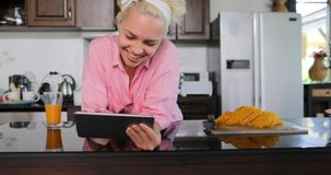 Girl Use Tablet Computer Laughing, Young Woman In Kitchen Chatting Online Studio Modern House Interior stock footage