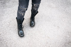 The girl in used black boots Royalty Free Stock Photography