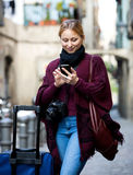 Girl uses gps on your mobile phone Stock Image