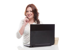 Girl uses a laptop Royalty Free Stock Photography
