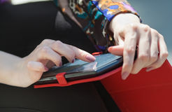 Girl uses touchpad outdoors Stock Images
