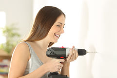 Free Girl Using A Drill In A Wall At Home Stock Photo - 92523960