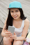 Girl using big modern phablet smartphone with dual camera Royalty Free Stock Photo