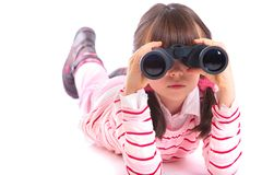 Girl using binocular Stock Image