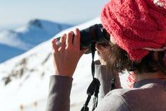 Girl using binocular Stock Images