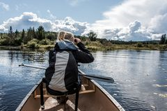 Free Girl Using Binocular On Canoe Lake Of Two Rivers In The Algonquin National Park In Ontario Canada On Sunny Cloudy Day Royalty Free Stock Images - 102911409