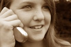 Girl using cellphone Stock Image