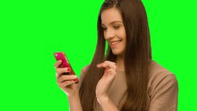 Girl using cellphone phone is switched on stock footage