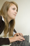 Girl using a computer Stock Images