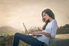 Girl using computer Royalty Free Stock Images