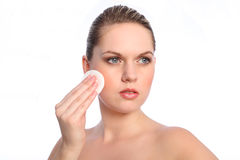 Girl using cosmetics cotton cleansing pad on face Royalty Free Stock Photography