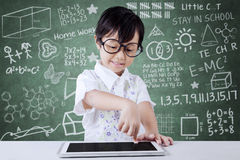 Girl using digital tablet in the class Stock Photo