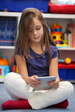 Girl using a digital tablet computer Stock Image