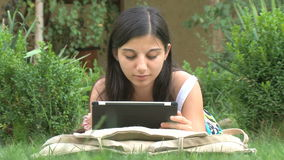 Girl using digital tablet Royalty Free Stock Image