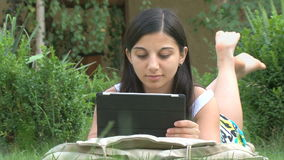 Girl using digital tablet. Outdoors stock video footage