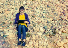 Girl using digital tablet Stock Photos