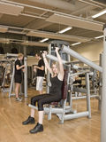 Girl using an exercise machine Royalty Free Stock Photo