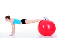 Girl using fitball Royalty Free Stock Photography