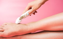 Girl using foot file to clean hard skin Stock Images