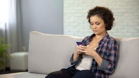 Girl using gadget, downloading mobile app to upgrade her smartphone, technology. Stock photo royalty free stock photography