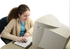 Girl Using Graphic Mouse. A teen girl at the computer using a graphic tablet and mouse Royalty Free Stock Photo