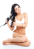 Girl using a hair iron Stock Photo