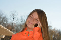 Girl using her cell phone. royalty free stock photography