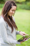 Girl using her digital tablet Stock Photo