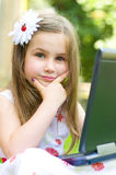 Girl using her laptop outdoor Stock Photography