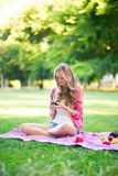Girl using her mobile phone Royalty Free Stock Photography