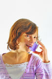 Girl using inhaler Stock Photo