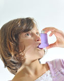 Girl using an inhaler Stock Photos