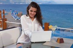 Girl Using Lap top Royalty Free Stock Photos