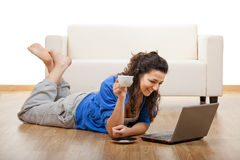 Girl using a laptop Stock Photography