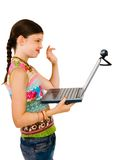 Girl using a laptop Stock Images